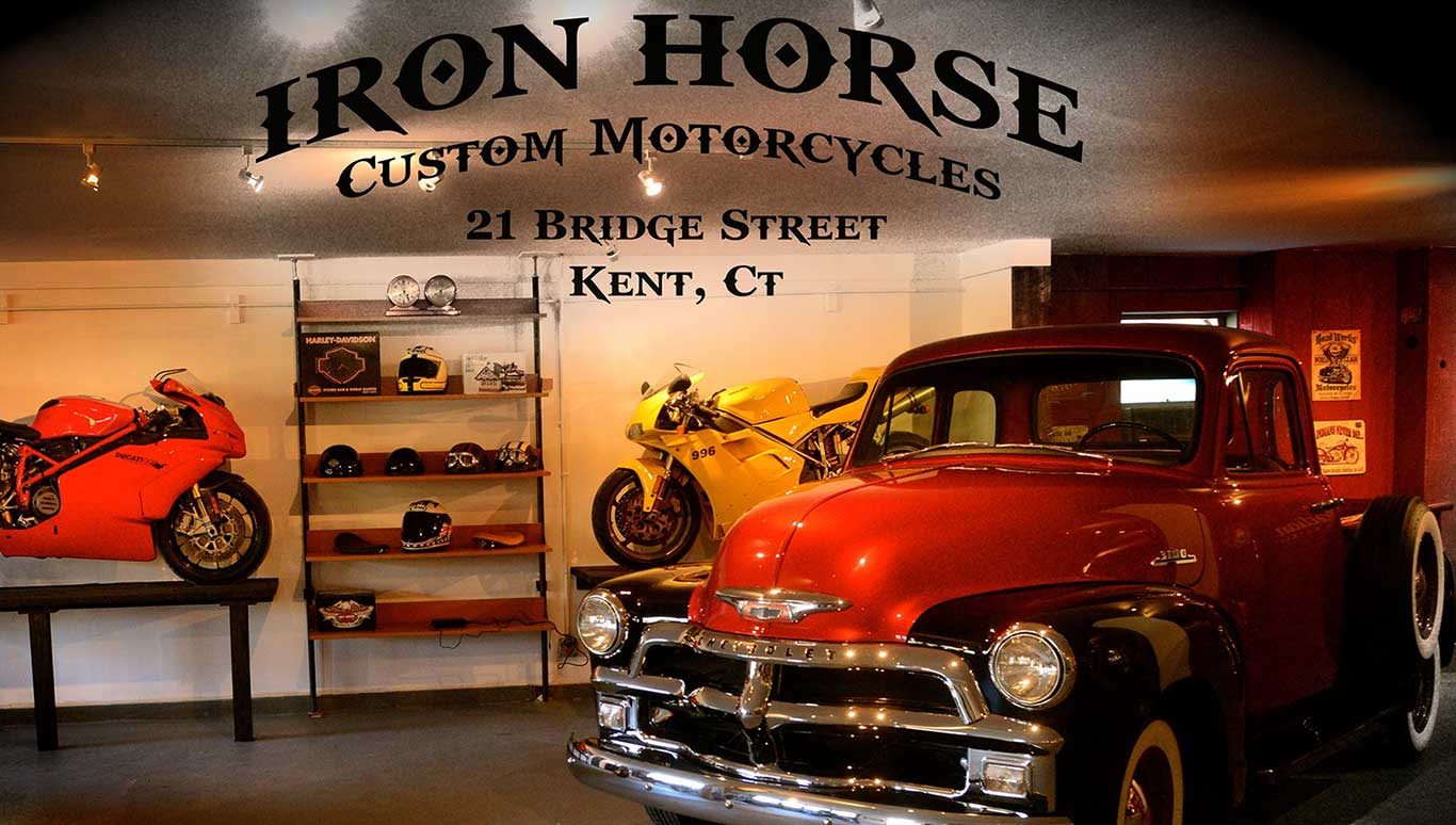 showroom floor at Iron Horse Customs with motorcycle and vintage truck on display